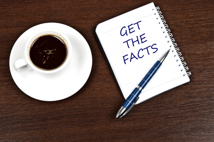 "desktop with coffee and pen and an open notebook that reads ""Get The Facts"""