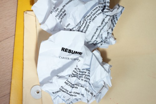 Resumes crumpled up and tossed in frustration.