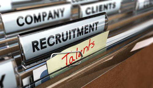 "Close up on a file tab with the text ""recruitment"" and a handwritten a note that says ""talents"""