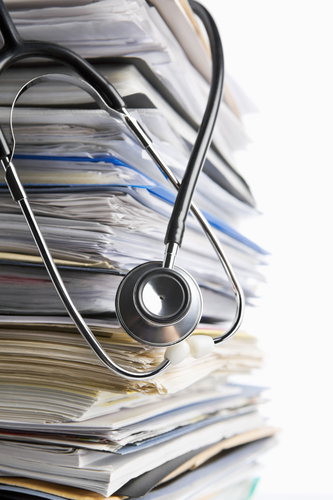 stack of medical regulations papers