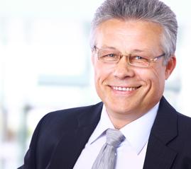 senior executive businessman smiling confidently