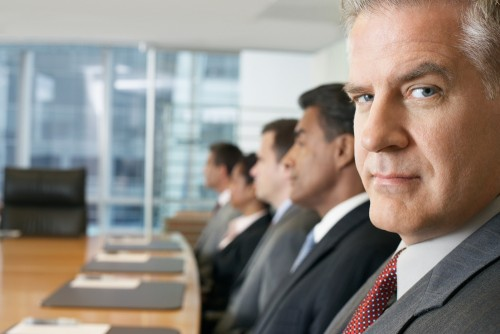 business people sitting in row at conference meeting