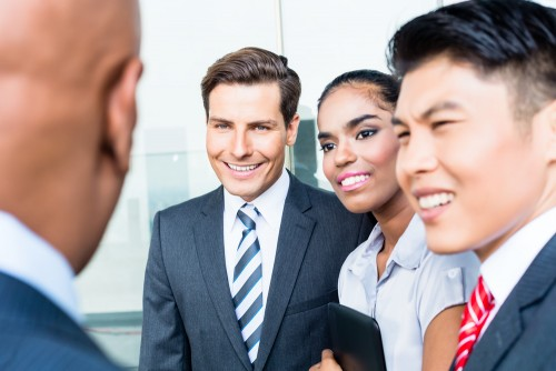 business people greeting each other and smiling