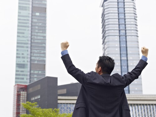businessman celebrating with arms raised