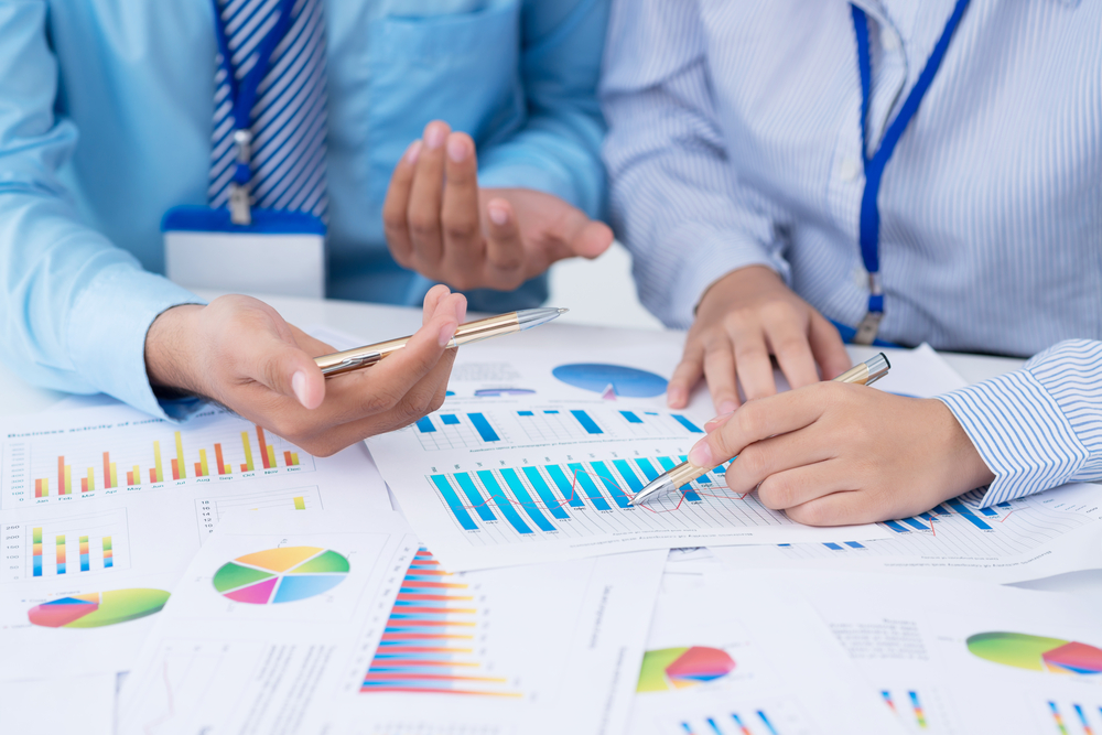 Hands of business people working with financial documents
