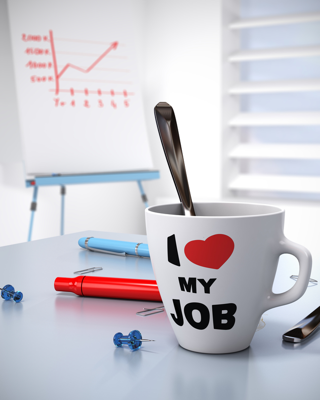 "Close up of a coffee mug that says ""I love my Job"" and a flipchart with a growing chart. Concept for Business performance and workplace well being."