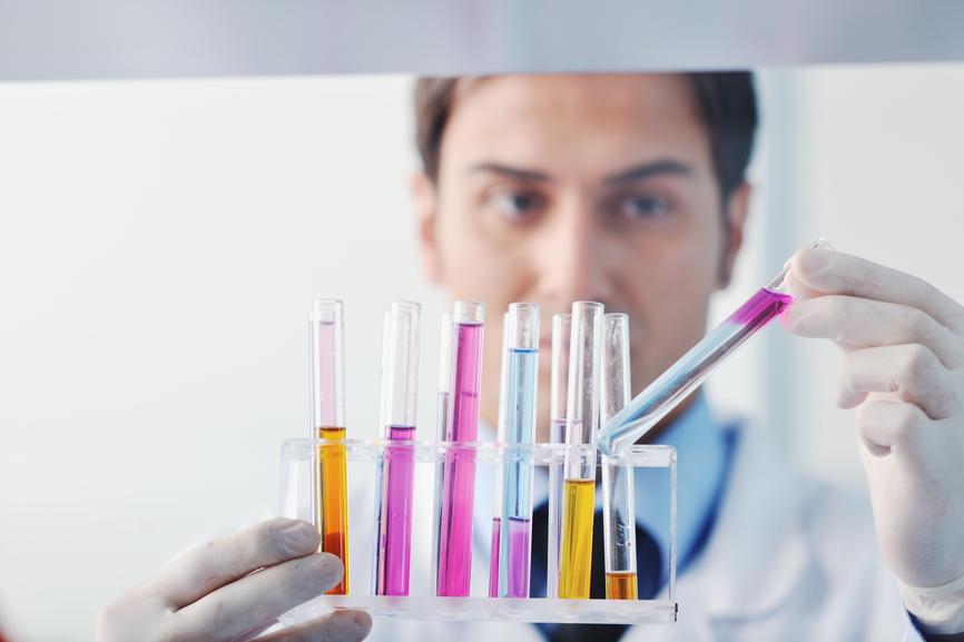 Research and development scientist working in bright laboratory - medicine concept