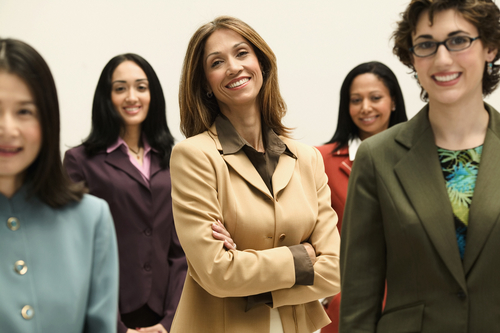 Group of businesswomen smiling.