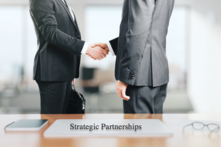 Two businessmen shaking hands, creating a strategic partnership