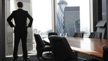 Business man looking out conference room window