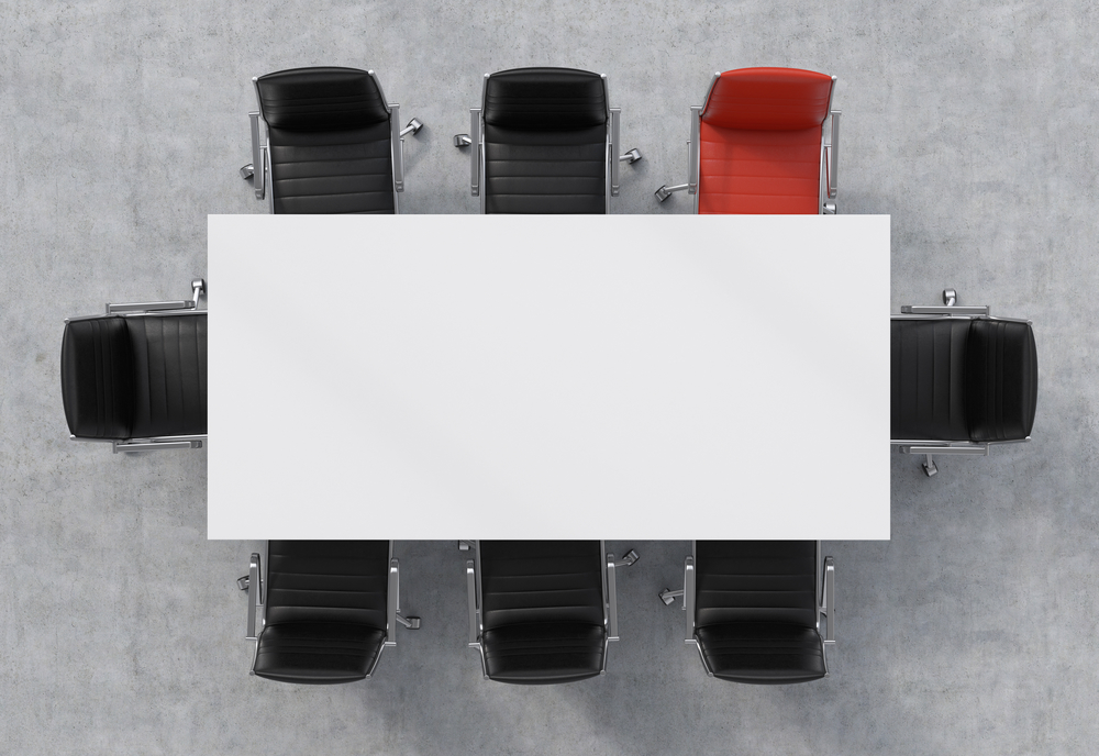 The ideal candidate's chair is saved at a conference room table.