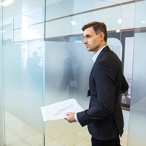 Confident businessman entering office